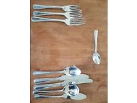 A Large Quantity of Johnsons Regeny Tableware and Stainless Steel Cutlery