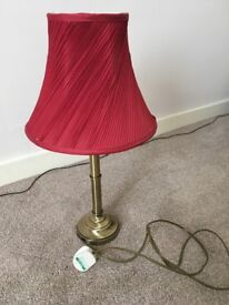 Beautiful table lamp. Pleated red lampshade on a brass (or similar metal?)stem & base