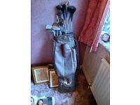Set of old golf clubs in a golf bag