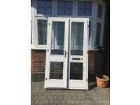 Pair of timber doors on a frame with double glazed leaded glass