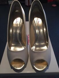 Ivory satin shoes by Rainbow Club