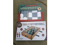 Giant draughts and table football board game foozeball