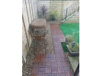 Decking tiles,artificial grass,shingle,wicker table and chairs