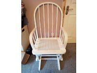 White wooden rocking chair