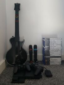 Ps2 with sing star, guitar hero and 21 games included