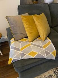 Matching cushions, rug, throw and pots.!