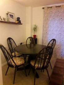 Original condition Ercol round extending table swan chairs and ercol seat pads