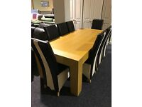 Solid large dining table and eight leather chairs
