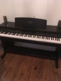 Yamaha electric clavinova piano