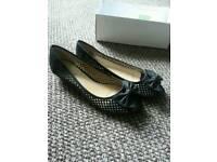 Black size 7 peep toe shoes
