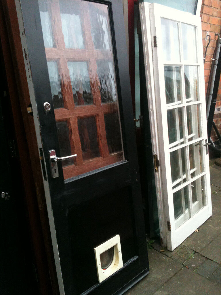 Exterior hardwood door with large crazed glass panel and catflap