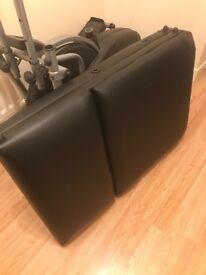 Black leather massage table