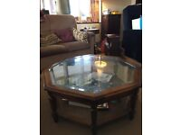 Octagonal glass topped coffee table. Excellent condition