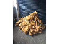 Large pile Seasoned ash logs