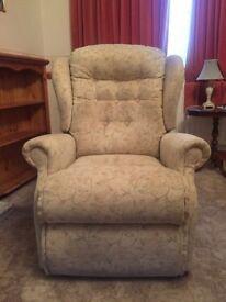 Recliner/Riser armchair (manual). Cream fabric
