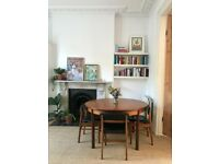 White and Newton mid-century teak extending dining table and four tuck-in chairs