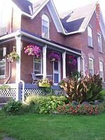 BEAUTIFUL TWO-STOREY TRIPLE BRICK VICTORIAN ON 2.87 ACRES