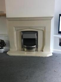 Marble fireplace with electric fire and stones