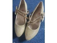 Girls shiny gold shoes