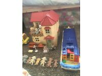 Collection of sylvanian families items including dolls and accessories