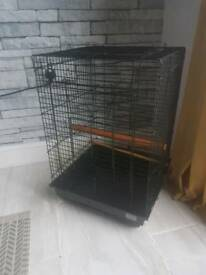 "Bird cage 23"" high by 16"" wide no feeding dishes very good condition"