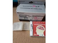 Ninetendo DS Lite essential pack plus 2 game boxes and 1 game