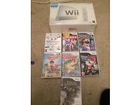 White boxed Nintendo Wii console + games