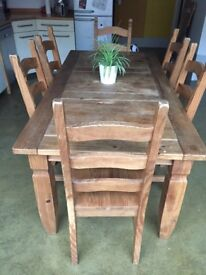 Solid oak dining room table and six chairs, fair condition.