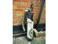 Set of golf clubs with bag and balls