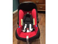 Britax Romer baby safe car seat in chili red.