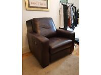 Reclining brown leather armchair