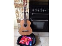 Jose Ferrer 3/4 Acoustic Guitar with stand, protective bag, first guitar book and tuner