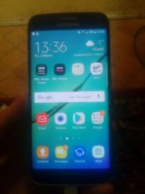 Samsung s6 edge 32gb used for only a week charger included