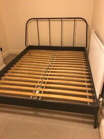 Metal framed kingsize bed (150cm) less than one year old