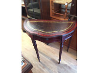 Leather topped half moon table , with small drawer . Size L 33in D 16in H 30in.