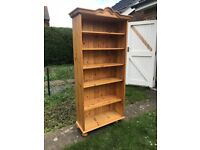 Solid pine bookcase with base shelf and 5 additional adjustable shelves.