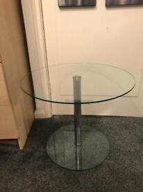 Small solid glass and chrome side table.