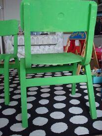 Two wooden children's school chairs