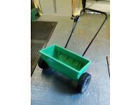 Lawn seed /fertilizer spreader