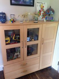 Display cupboard with storage