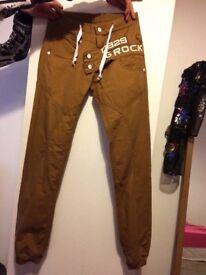 Pair of men's/boys 28/30 inch waist tobacco colour cuffed jeans
