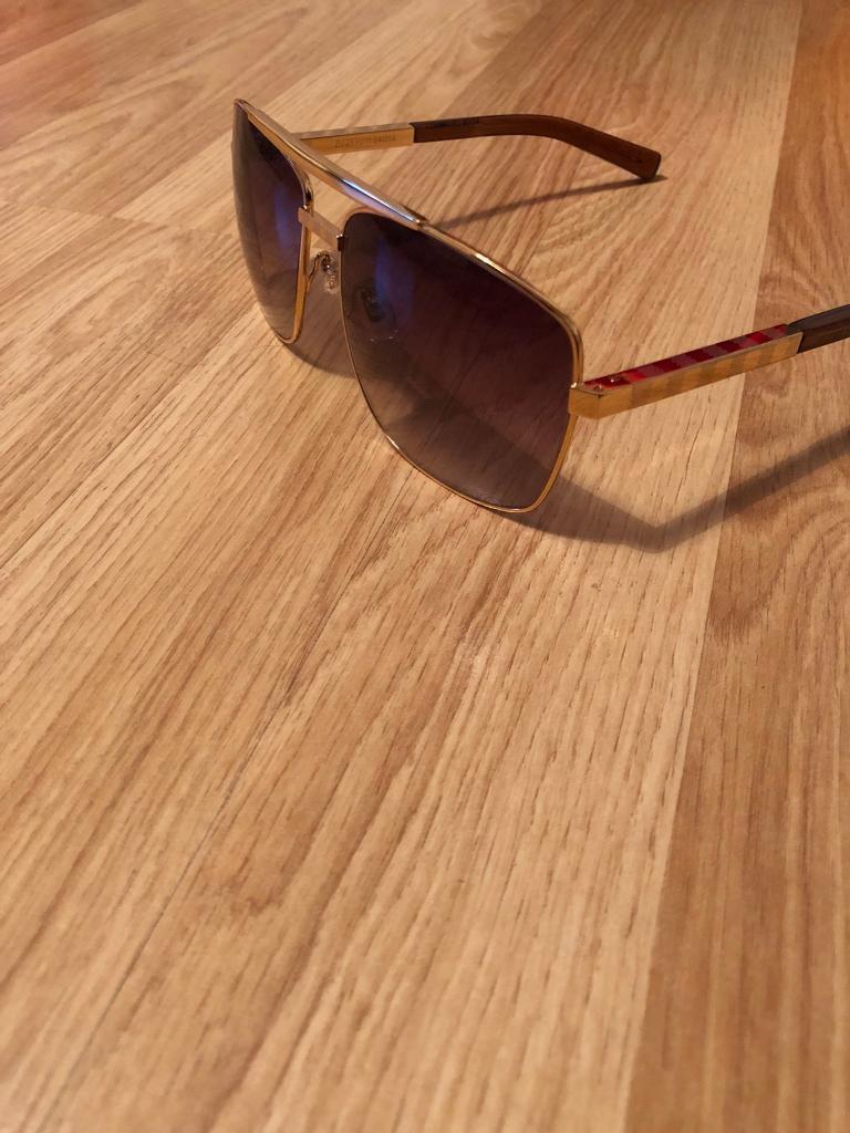 ecb6a57638f Louis Vuitton LV attitude sunglasses gold