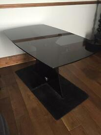Black glass dining table measures 130 x 80