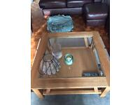 Wooden coffee table with square glass top