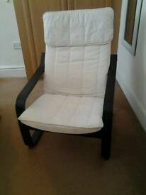 Black chair with cream cushion seat