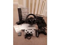 Slim Sony PS2, 2 controllers, steering wheel, pedals, 8MB memory card and 25 games