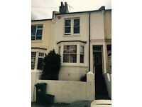 Terrace house, BN2. Free parking. Local to unniversities, train and bus. Nr City. Mature Garden.