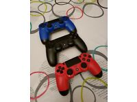 3 PlayStation controllers in Red,Blue & Black.