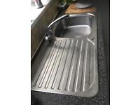 Stainless sink and taps