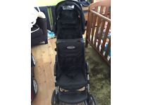 Double buggy for todler and baby.